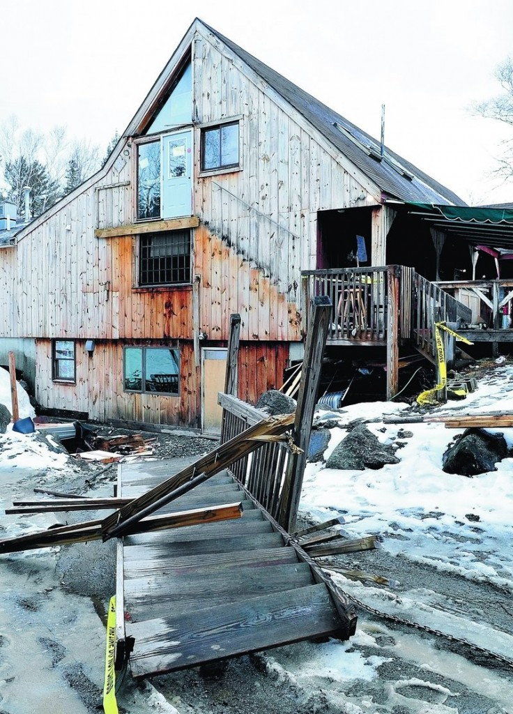A set of stairs leading to a second floor doorway at the Rack bar and grill restaurant in Carrabassett Valley lies on the ground Sunday where it fell after 10 patrons assembled on the top landing around midnight on Saturday. Five people went to the hospital with injuries.