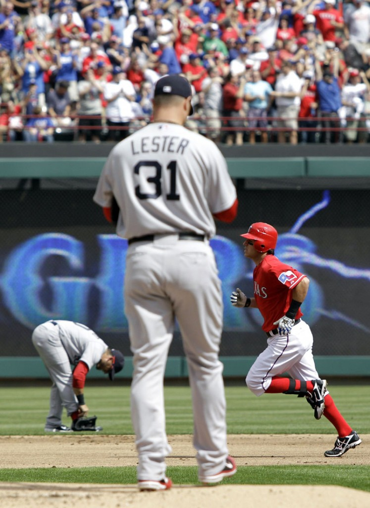 NOT IDEAL START: Boston Red Sox pitcher Jon Lester, left, walks to the back of the mound as Texas Rangers second baseman Ian Kinsler rounds the bags following his leadoff home run in the first inning Friday in Arlington, Texas. Lester allowed five runs — and three home runs — in 5 1/3 innings.