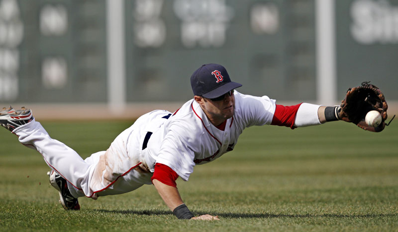 DIVING STOP: Boston Red Sox second baseman Dustin Pedroia dives and catches a sharp grounder hit by New York Yankees first baseman Mark Teixeira during the sixth inning Saturday at Fenway Park in Boston. Pedroia threw Teixeira out at first base, but the Red Sox lost 9-4.
