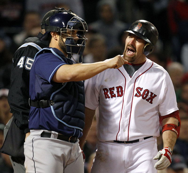 CAUGHT LOOKING: Boston Red Sox third baseman Kevin Youkilis, right, argues a called third strike by umpire Jeff Nelson, left, as Tampa Bay Rays catcher Kelly Shoppach looks on during the sixth inning Tuesday night at Fenway Park in Boston.