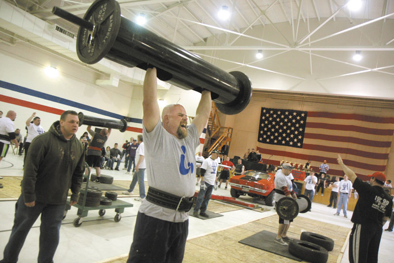 A STRONG MAN: Andrew Beckim of Vassalboro lifts 180 pounds while competing in the log press event at the fifth annual Central Maine Strongman competition at the Augusta Armory on Saturday.