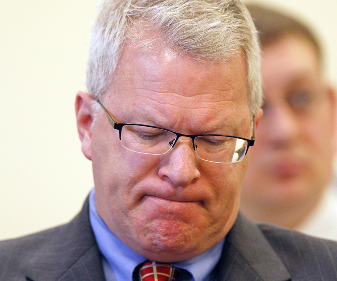 Paul Violette, former executive director of the Maine Turnpike Authority, grimaces before appearing before the Legislature's Government Oversight Committee today.