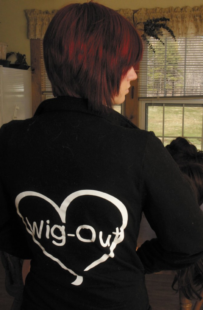 Rachel Fortin, 19, of West Gardiner wears a sweatshirt promoting her home business called Wig-Out which was started to help cancer patients and other people who have lost their hair find a sense of confidence in dealing with their illness. Fortin said her boss at Shania Boyton at Access Worldwide in Augusta, who is a cancer survivor, inspired her to start the business.