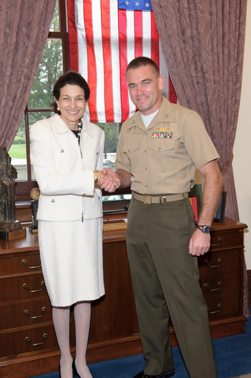 Senator Snowe welcomes Captain Coté to Washington.