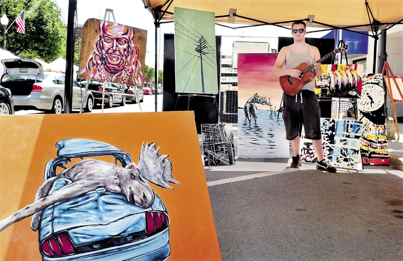 MULTI-TALENTED: Artist and musician Ryan Kohler diplays his talents Saturday during the Waterville Intown Arts Fest.