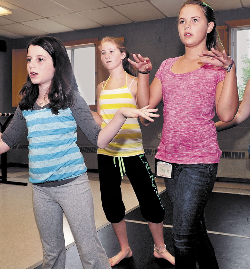 COOL CAMP: Rachylle Hart, center, takes part in a hip-hop class with fellow campers Ellie Rader, left, and Anna Braman at the Maine Arts Camp at Unity College last week.