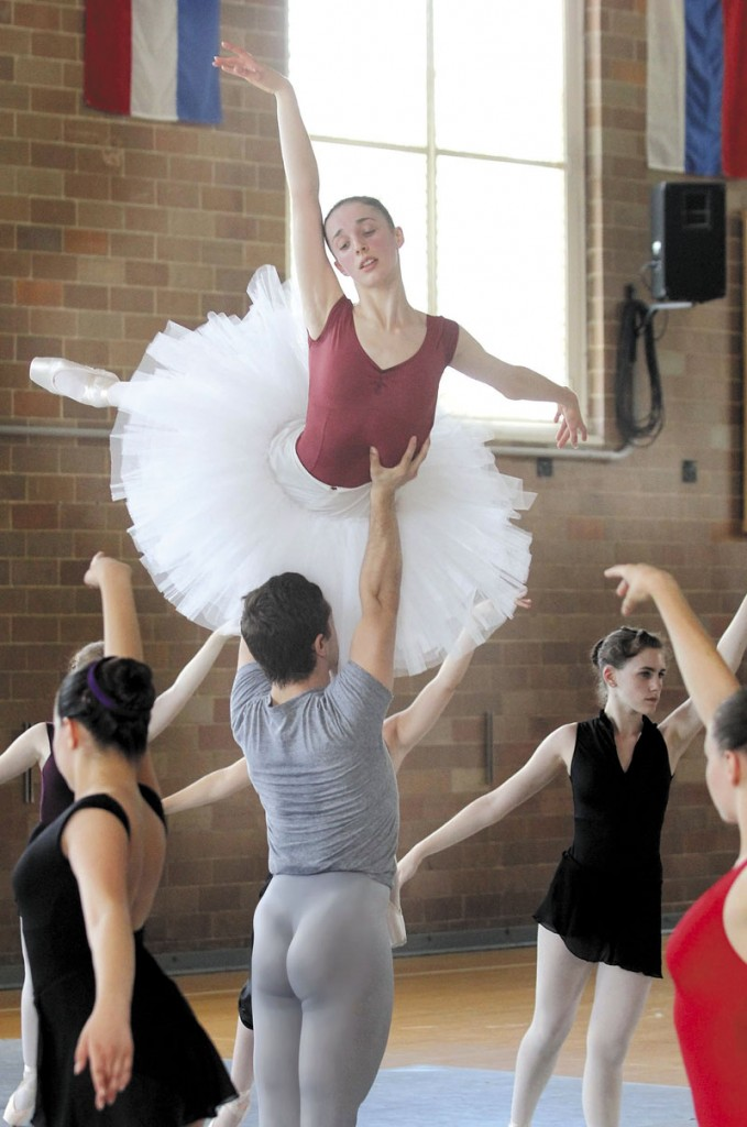 """BIG LIFT: Ryan Jolicoeur-Nye and Caroline Doherty rehearse for the Bossov Ballet Theatre's production of """"Swan Lake"""" in Pittsfield on Thursday. Joliecoeur-Nye is a former football player turned ballet dancer."""
