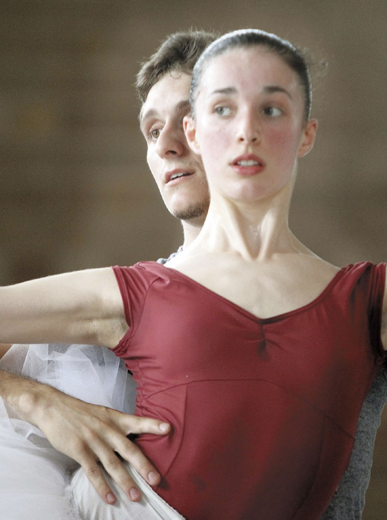 """Ryan Jolicoeur-Nye listens to instructions from Andrei Bossov while rehearsing with Caroline Doherty for the Bossov Ballet Theatre's production of """"Swan Lake"""" in Pittsfield recently."""