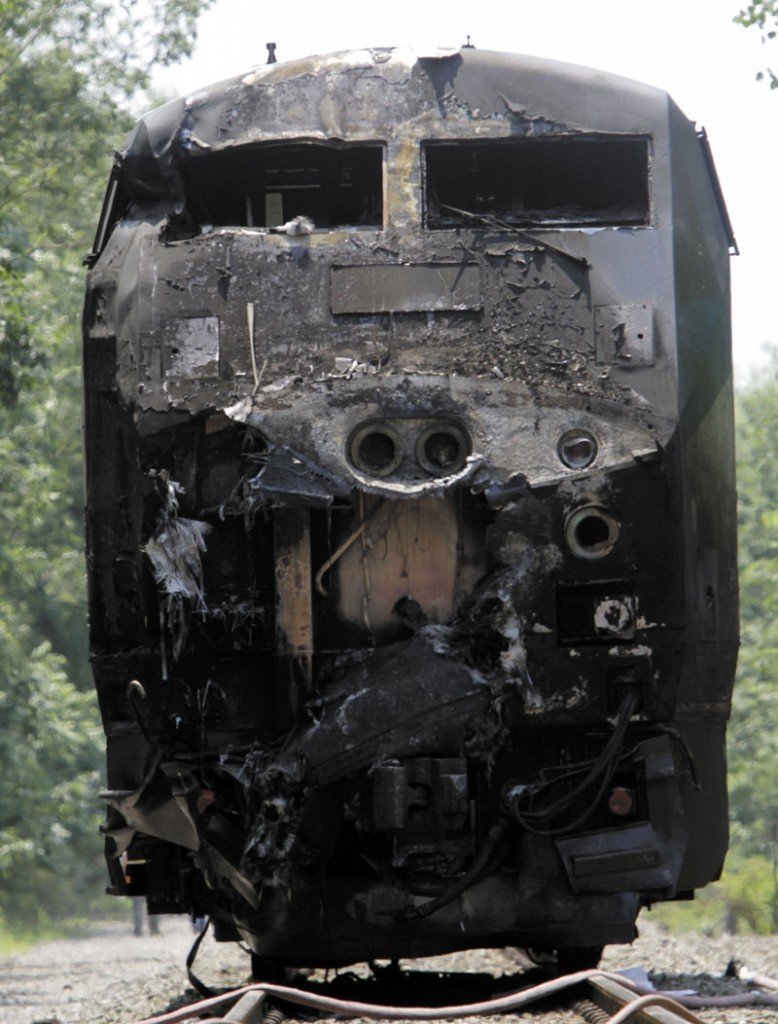FATAL CRASH: The charred engine of the Amtrak train that collided into a tractor-trailer is seen Monday in North Berwick. Both were set on fire and the truck driver, identified by police as Peter Barnum of Farmington, N.H., was killed. The crash occurred about 11 a.m.