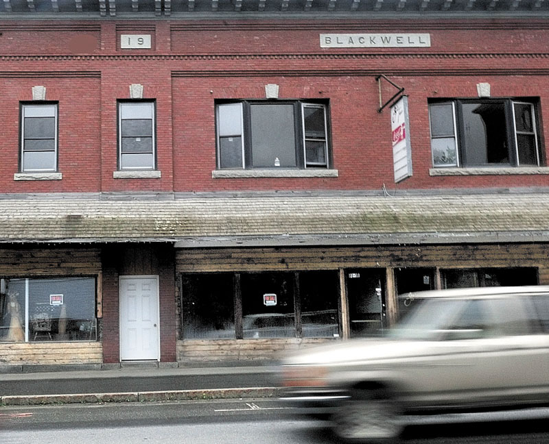 ROOM TO GROW: Motorists pass the empty Blackwell block where for sale signs dominate storefront windows in downtown Madison. Residents approved the Madison Downtown Comprehensive Plan in an effort to identify deteriorating buildings, expand the downtown area and make grant opportunities available.