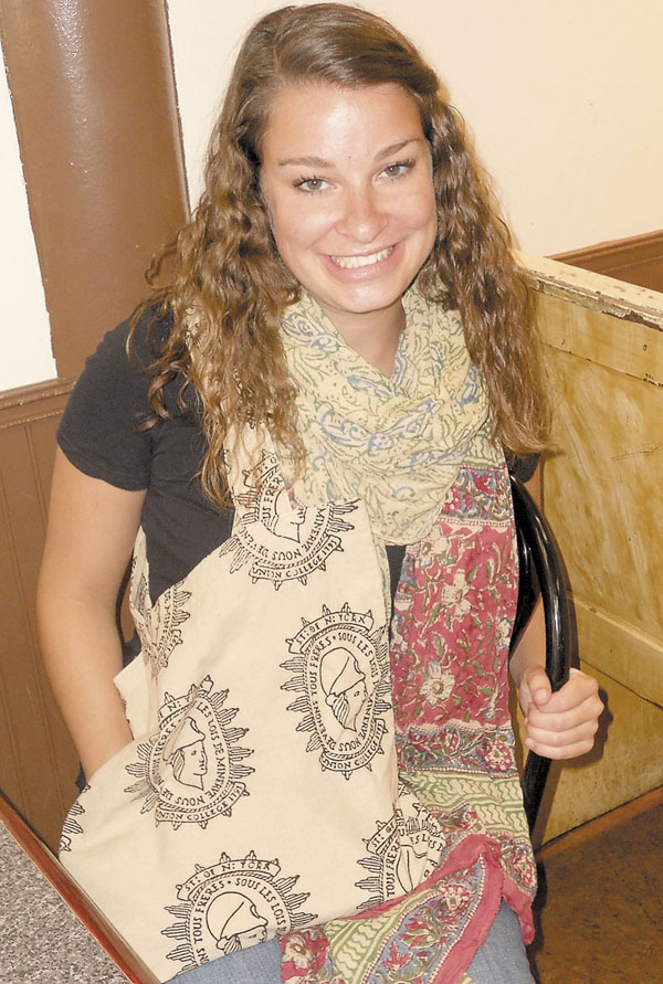 MAKING A DIFFERENCE: Emily LaCroix displays a Bagru Textiles scarf and a bag with Union College's logo.
