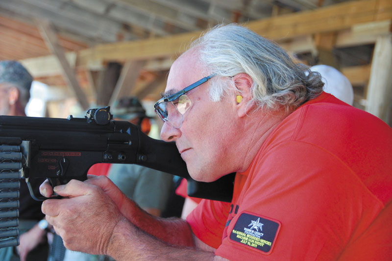 SHOOTING EVENT: Dwight Dodge, 56, of Paris, takes aim in the Warrior Legacy Foundation's Wounded Heroes Machine Gun Shoot on Sunday in North Anson.