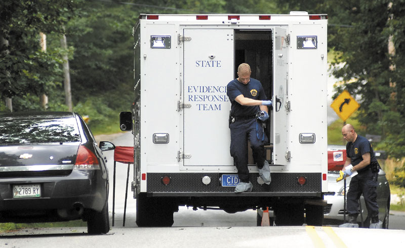 State Police collect evidence Tuesday at the scene of a shooting at 322 Bennett Road in New Gloucester. Renee Sandora, the mother of four children, was shot Monday and died Tuesday.