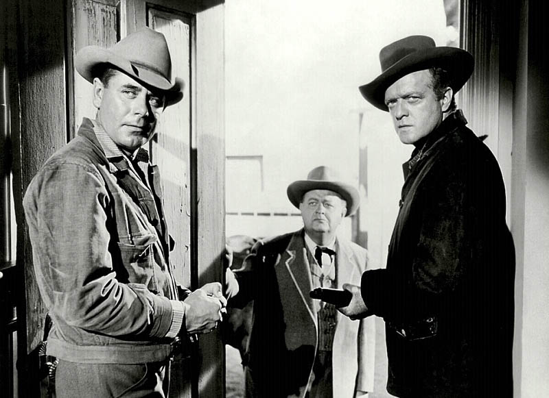"""WHAT A MAN HAS TO DO: Glenn Ford, left, and Van Heflin star in the Western film classic """"3:10 to Yuma."""" Robert Emhardt is in the middle."""
