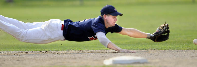 BELLY PLAY: Augusta shortstop Colin McKee dives for a groundball during an American Legion Zone 2 playoff game Monday in Augusta.