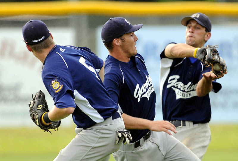HEADS UP: Gardiner 's Cody Plourde, right, Forrest Chadwick, center, and Spencer Allen converge in center field as Plourde catches a popup Monday during an American Legion Zone 2 playoff game Monday in Augusta.