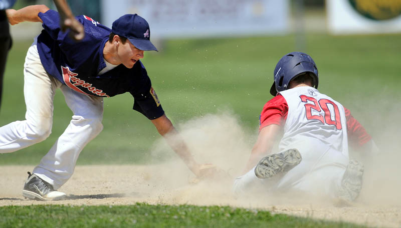 LATE: Augusta's Chandler Shostak, left, tries unsuccessfully to tag Post 51's Sam Dexter as Dexter slides safely into second base during the Zone 2 tournament Sunday in Augusta.