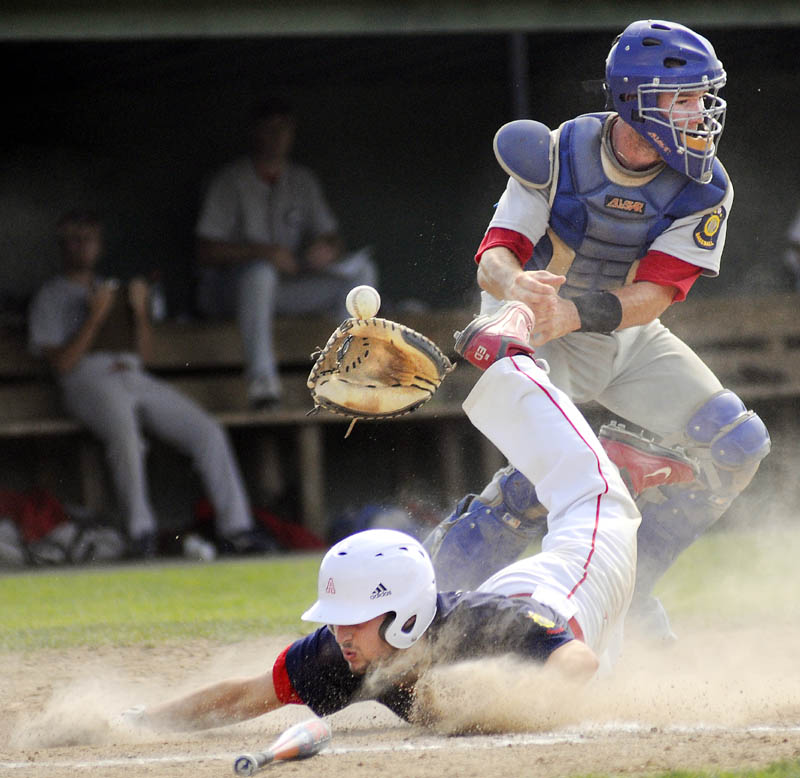 TOUGH SLIDE: Augusta's Ryan Edwards knocks the glove and ball away from Gayton Post catcher Mekae Hyde while sliding into home Thursday during Augusta's 21-11 win in the American Legion Baseball state tournament in Augusta.