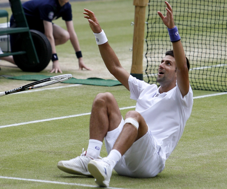 Novak Djokovic celebrates after defeating Rafael Nadal today in the men's singles final at the All England Lawn Tennis Championships at Wimbledon.