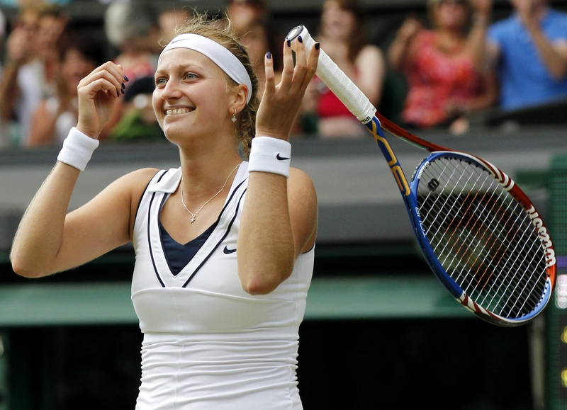 Petra Kvitova celebrates after defeating Maria Sharapova in the women's singles final at the All England Lawn Tennis Championships at Wimbledon today. The 6-3, 6-4 win gives Kvitova her first Grand Slam title.