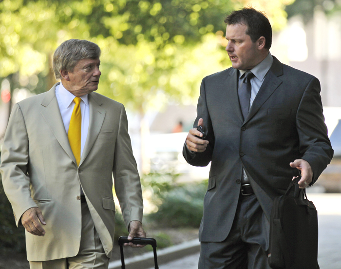 Former Major League Baseball pitcher Roger Clemens, right, and his attorney Rusty Hardin, arrive at federal court in Washington today.