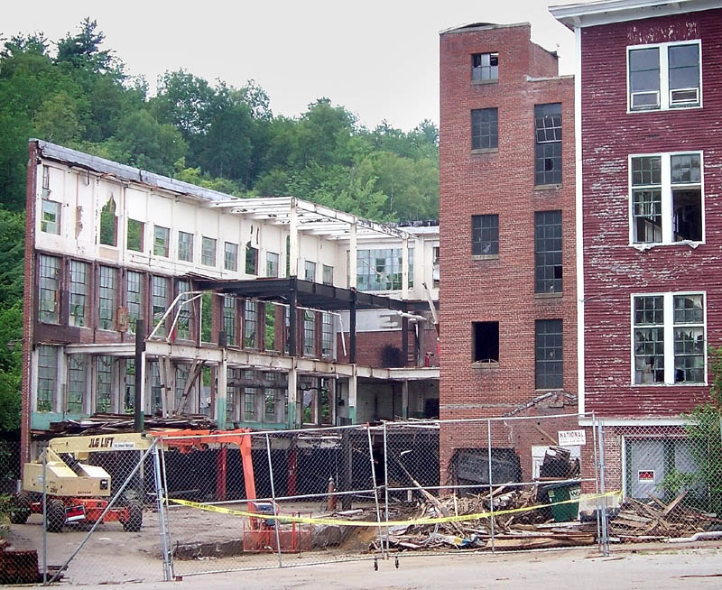 A DANGEROUS SITE: Police tape blocks the entrance to the former Forster Manufacturing Co. building complex Thursday on Depot Street in Wilton. The demolition site has been closed down amid reports of dangerous levels of airborne asbestos, according to Bill Coffin, director of the federal Occupational Safety and Health Administration in Maine.