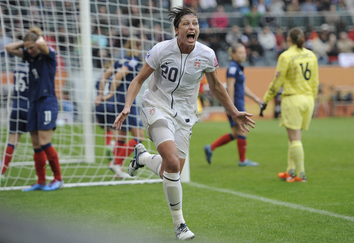 United States' Abby Wambach celebrates scoring her side's 2nd goal during the semifinal match between France and the United States at the Women's Soccer World Cup in Moenchengladbach, Germany, today.