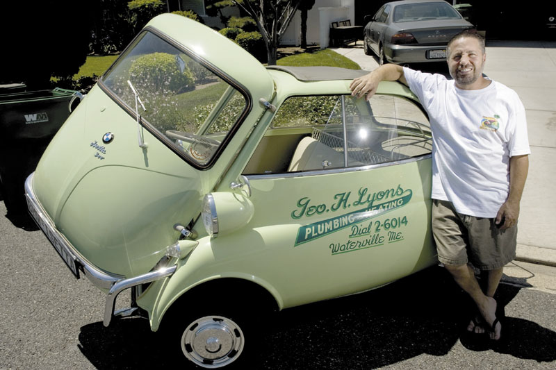 "PROUD OWNER: A 1957 BMW Isetta, once driven around Waterville, is the car Tustin, Calif., mini-car collector David Raab says he would save if he could only pick one in a fire. ""A car's only original once,"" he said of the green micro-car."