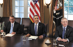 President Barack Obama, ,flanked by House Speaker John Boehner of Ohio, left, and Senate Majority Leader Harry Reid of Nev., meets with Republican and Democratic leaders regarding the debt ceiling on Monday in the Cabinet Room of the White House in Washington.