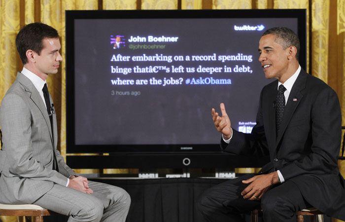 "President Obama sits with Twitter co-founder and Executive Chairman Jack Dorsey as he answers a tweet from House Speaker John Boehner of Ohio during a ""Twitter Town Hall"" in the East Room of the White House today"