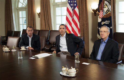President Barack Obama meets with Senate Majority Leader Harry Reid of Nev., right, and House Speaker John Boehner of Ohio, left, in the Cabinet Room of the White House, Saturday, July 23, 2011, in Washington, to discuss the debt.