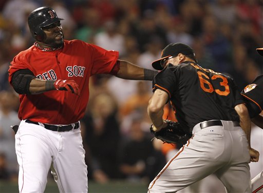 Boston Red Sox designated hitter David Ortiz takes a swing at Baltimore Orioles relief pitcher Kevin Gregg (63) after they exchanged words after Ortiz flied out during the eighth inning Friday at Fenway Park in Boston.