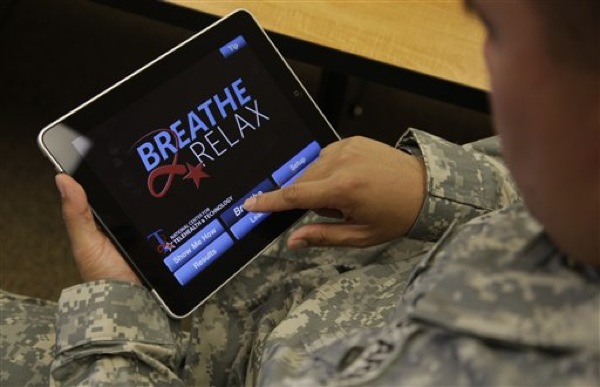 Sgt. Mark Miranda, a public affairs specialist stationed at Joint Base Lewis-McChord in Washington state, demonstrates the use of a program for tablet computers and smart phones that is designed to help calm symptoms of post-traumatic stress and traumatic brain injury, Friday, July 22, 2011. Miranda said he does not suffer from PTSD, but after trying the app, he said he may suggest its use to other soldiers who he has deployed with. (AP Photo/Ted S. Warren)