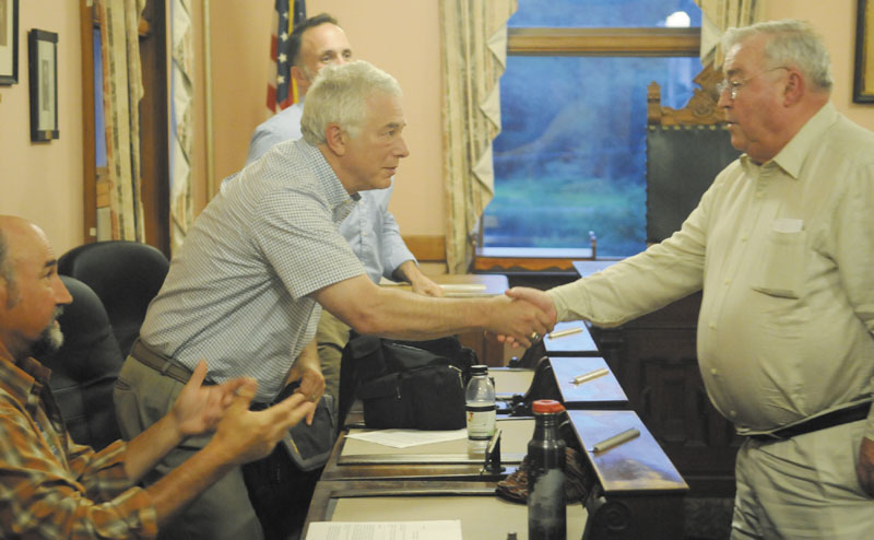 Peter Prescott, right, thanks Hallowell tax incremental finance committee member Joel Davis after meeting with the group Tuesday about Prescott's request that the city reduce taxes for a proposed ice arena he wants to build in the city to replace the Kennebec Ice Arena, which collapsed last winter. City Councilors Stephen Vellani, left, and Edmund J. Cervone also serve on the committee.