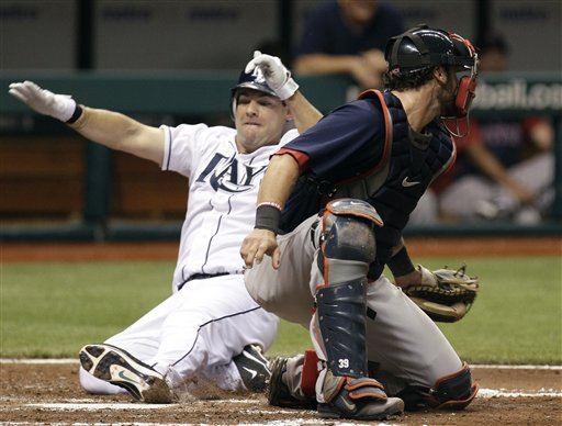 Tampa Bay's Casey Kotchman, left, scores past Boston Red Sox catcher Jarrod Saltalamacchia on a third inning single by Sam Fuld on Friday in St. Petersburg, Fla.