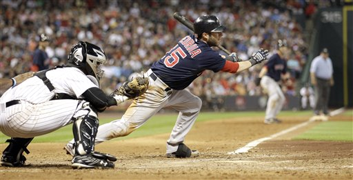 Boston's Dustin Pedroia (15) hits a two-run single in the seventh inning of the Red Sox' 7-5 win over the Astros on Friday in Houston.