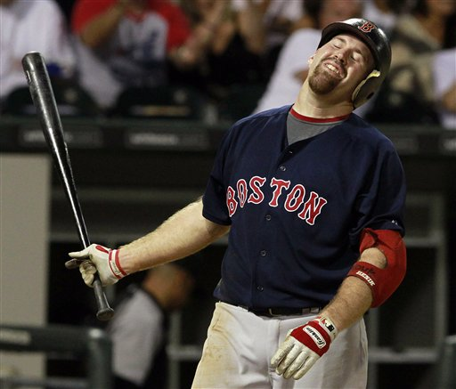 Boston Red Sox's Kevin Youkilis reacts as he strikes out with the bases loaded against the Chicago White Sox in the sixth inning of a baseball game on Friday, July 29, 2011, in Chicago. (AP Photo/John Smierciak) Baseball