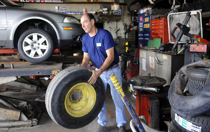 SLOW GOING: Greg Chapman said business has been slow at his garage on Bridge Street in Gardiner. Recently, Chapman repaired a tractor tire in addition to servicing a vehicle. Up the road, retail sales in the Augusta area fell $1.5 million, or 0.6 percent, in May 2011 when compared to May 2010. But that was after a surge that saw sales rise 2.8 percent, or $2 million, in April 2011 from April 2010.