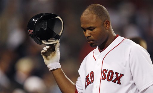 Boston's Carl Crawford takes off his batting helmet as he heads back to the dugout after striking out with two men on against the Kansas City Royals in the 11th inning Monday at Fenway Park in Boston.