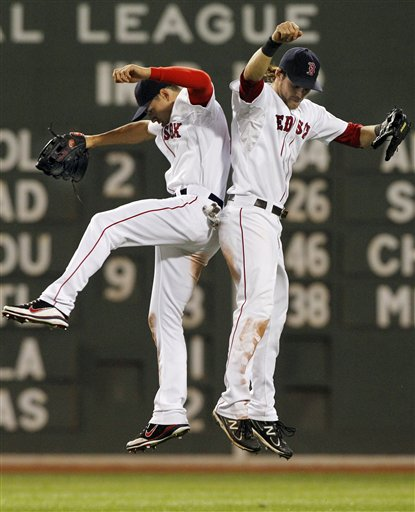 Boston Red Sox outfielders Jacoby Ellsbury, left, and Josh Reddick celebrate their 13-9 victory over the Kansas City Royals on Tuesday at Fenway Park in Boston.