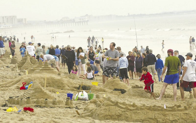 HEAVY COMPETITION: The beach was filled with families sculpting sand for the Ocean Park Family Sand Sculpture Competition on Sunday in Old Orchard Beach.