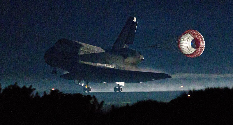 LAST LANDING: The drag chute is deployed as the space shuttle Atlantis lands Thursday at Kennedy Space Center in Florida, completing STS-135, the final mission of the NASA shuttle program. NASA STS-135 atlantis explorati