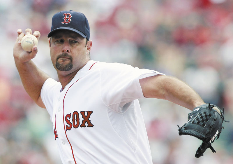 MILESTONE DAY: Boston pitcher Tim Wakefield earned his 199th career victory Saturday as the Red Sox beat the Seattle Mariners 12-8 at Fenway Park in Boston. Wakefield also recorded his 2,000th strikeout in a Red Sox uniform.