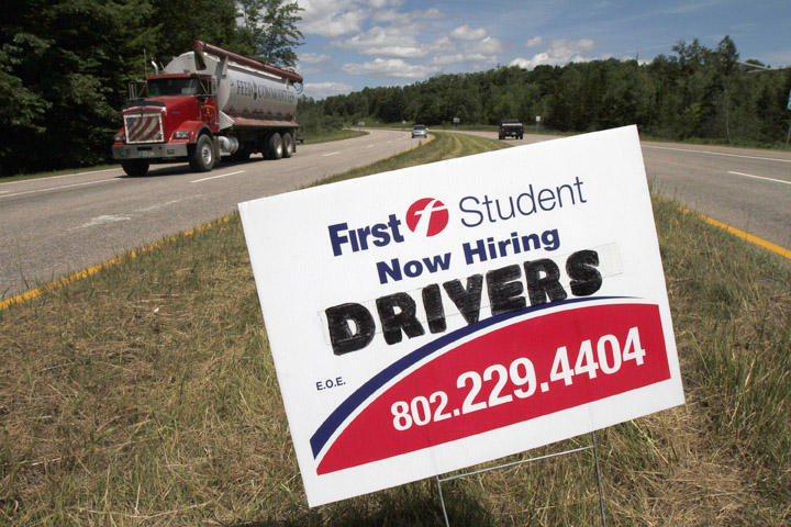 A sign looking to hire drivers, is placed on a roadway in Berlin, Vt., on Thursday. In June, employers added only 18,000 jobs nationwide.