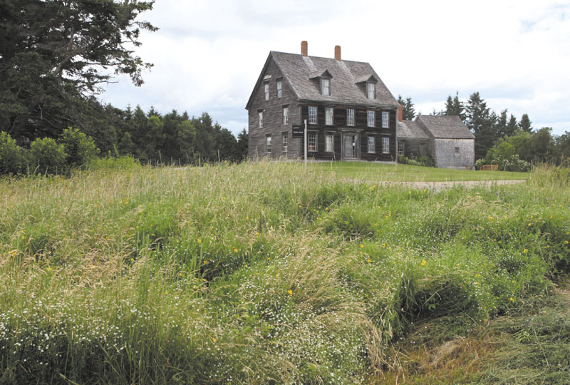 "The Olson House, where Andrew Wyeth painted ""Christina's World,"" is seen Friday in Cushing. The house was one of 14 locations to receive a national landmark designation from U.S. Secretary of the Interior Ken Salazar."