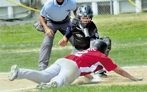 NICE PLAY: Central Maine's cather Bobby Chenard tags out Portland's Jordan Floridino at a plate at the plate Saturday during the 14-year-old Babe Ruth state tournament Saturday at Lawrence High School in Fairfield.