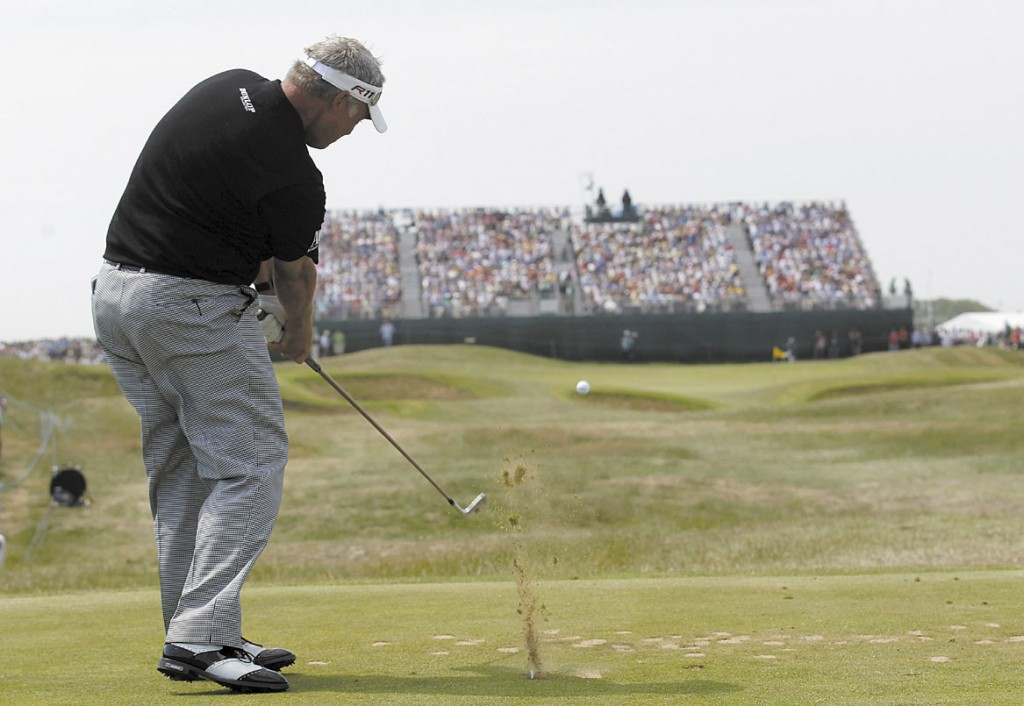 HIT TO THE HOLE: Northern Ireland's Darren Clarke plays a shot on the 16th fairway during the second day of the British Open on Friday at Royal St George's golf course Sandwich, England.