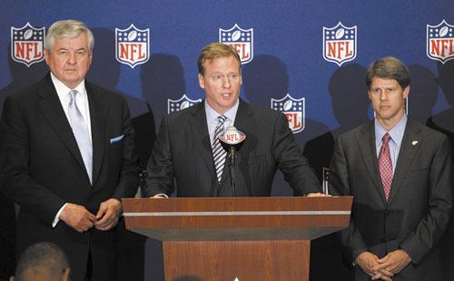 IT'S GOOD FOR US: NFL commissioner Roger Goodell, center, announces that NFL owners have agreed to a tentative agreement that would end the lockout pending the players' approval Thursday in College Park, Ga. Carolina Panthers owner Jerry Richardson, left, and Kansas City Chiefs owner Clark Hunt look on.