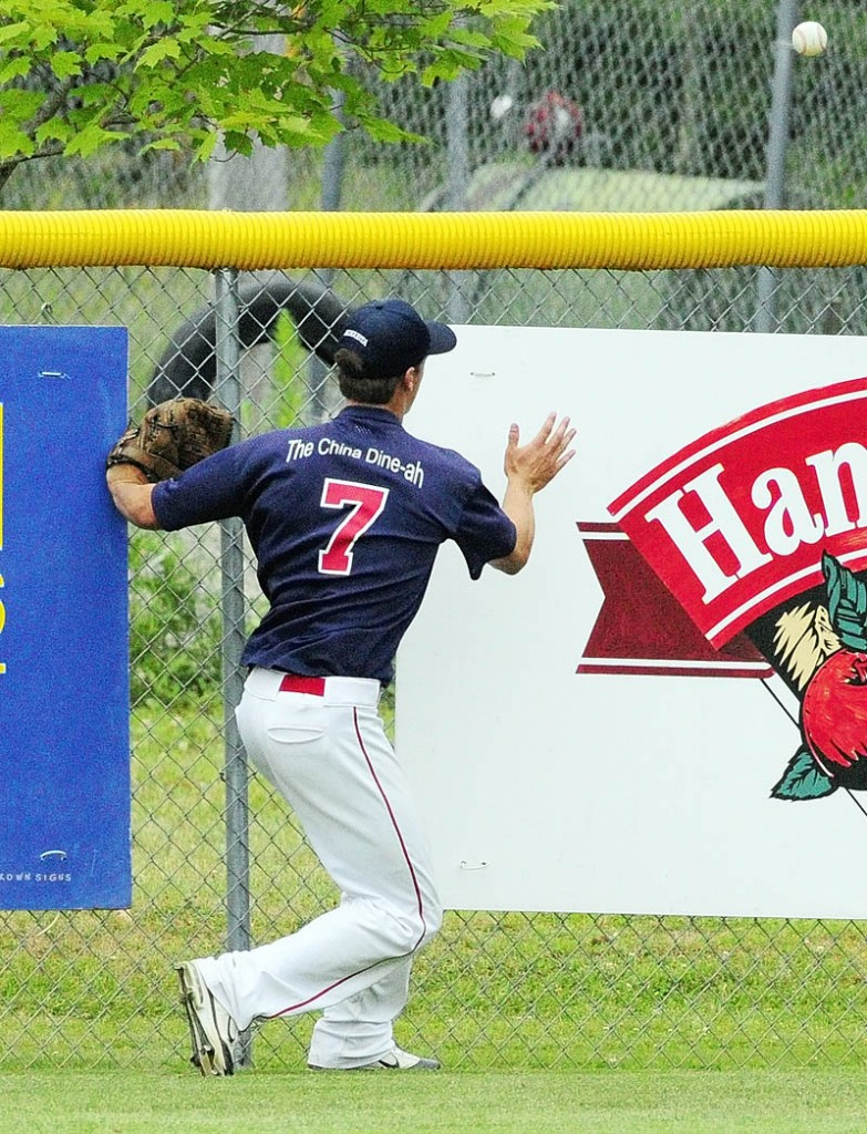 Luke Duncklee watches a long fly ball hit by Bangor hitter Dylan Morris bounces over the outfield wall for a ground rule double on Friday afternoon in Augusta.