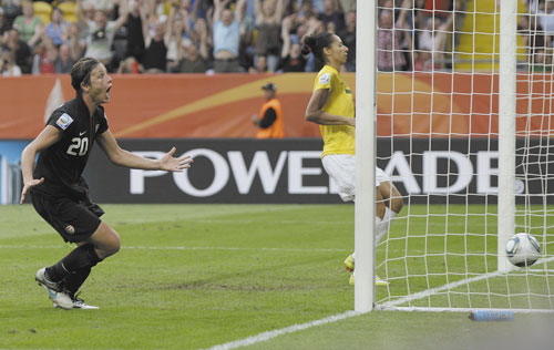CLOSING THE GAP: United States' Abby Wambach reacts after scoring her team's second goal during a quarterfinal match against Brazil at the Women's World Cup on Sunday in Dresden, Germany. The U.S. won 5-3 on penalty kicks after 2-2 tie to advance to the semifinals.